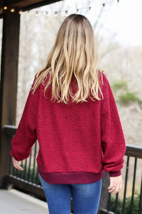 Model wearing the Teddy Sherpa Turtleneck Sweater from Dress Up in Burgundy Back View