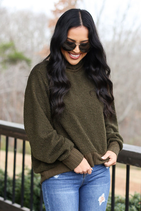 Model wearing the Teddy Sherpa Turtleneck Sweater from Dress Up in Olive Front View