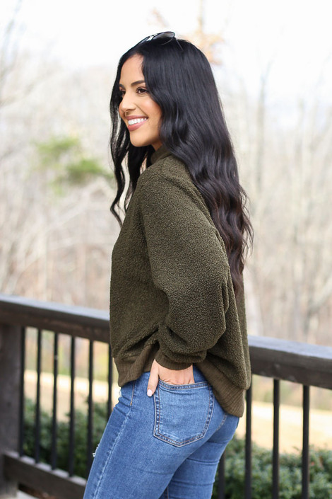 Model wearing the Teddy Sherpa Turtleneck Sweater from Dress Up in Olive Side View