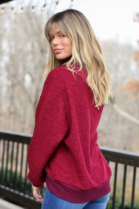 Model wearing the Teddy Sherpa Turtleneck Sweater from Dress Up in Burgundy Side View