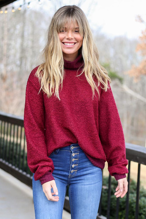 Model wearing the Teddy Sherpa Turtleneck Sweater from Dress Up in Burgundy Front View