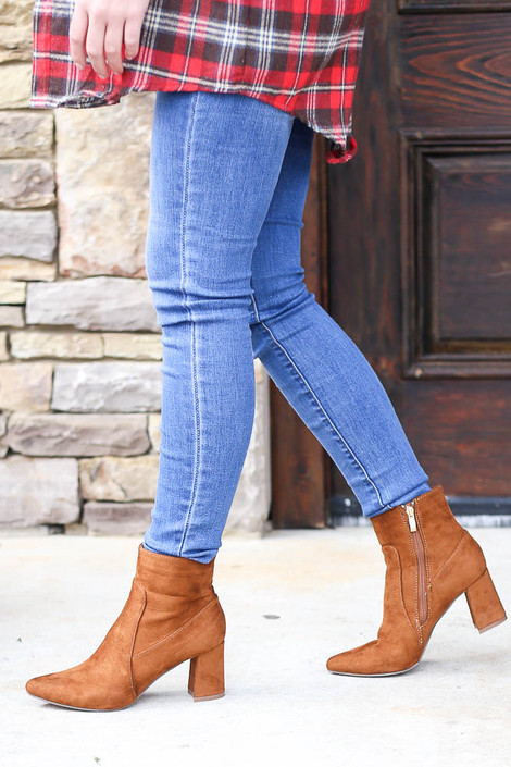 Model wearing the Pointed Toe Block Heel Booties in Camel with Skinny Jeans from Dress Up