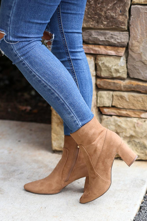 Model wearing the Pointed Toe Block Heel Booties in Tan with Skinny Jeans from Dress Up