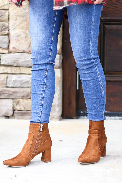 Model wearing the Pointed Toe Block Heel Booties in Camel with Skinny Jeans and Flannel Top from Dress Up