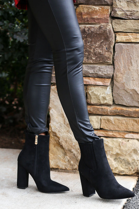 Model wearing the Black Block Heel Ankle Booties from Dress Up with faux leather leggings