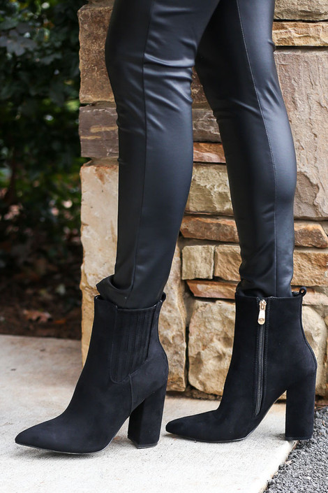 Model wearing the Black Block Heel Ankle Booties with Faux Leather Leggings from Dress Up Side View