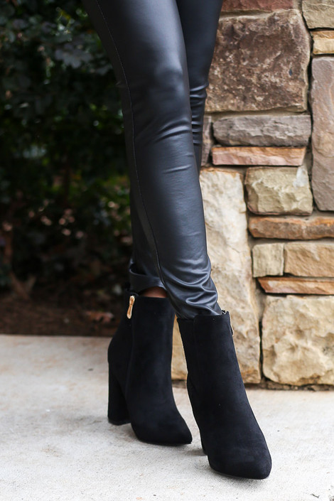 Model wearing the Black Block Heel Ankle Booties with Faux Leather Leggings from Dress Up Front View