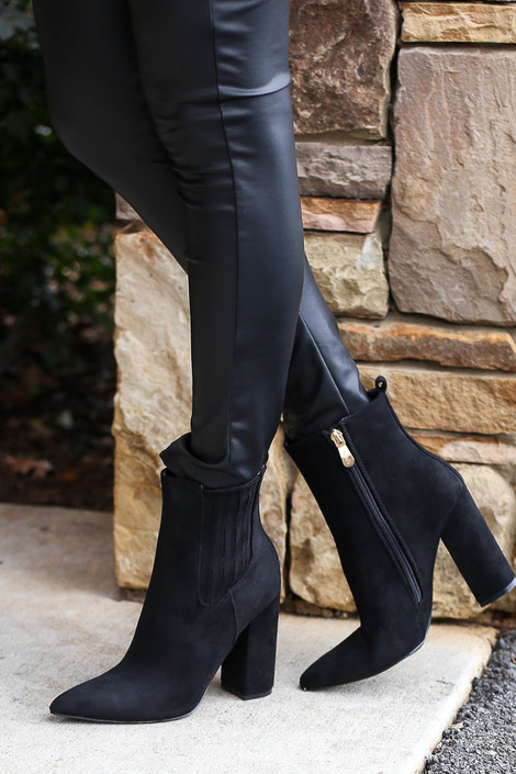 Model wearing the Black Block Heel Ankle Booties from Dress Up Side View