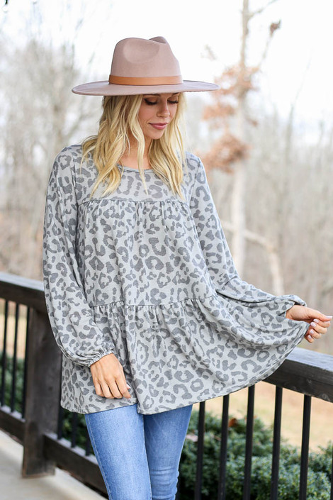 Model wearing the Grey Leopard Tiered Babydoll Tunic with wide brim hat Front View