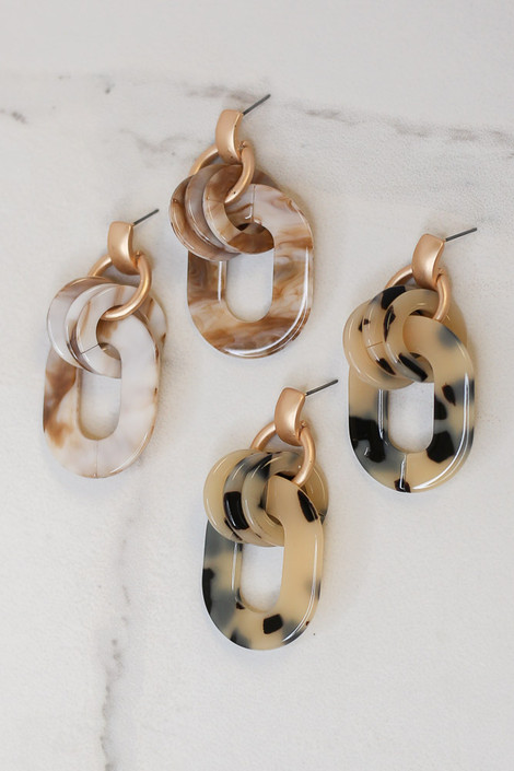 Flat lay of both colors of the Acrylic Statement Earrings from Dress Up