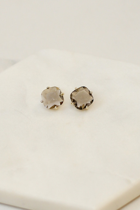 Grey - Flat lay of the grey pair of earrings in the Gemstone Stud Earrings set