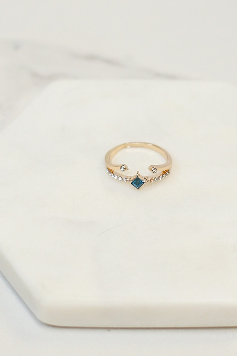 Flat Lay of pronged ring from the Gold Stone Dainty Ring Set