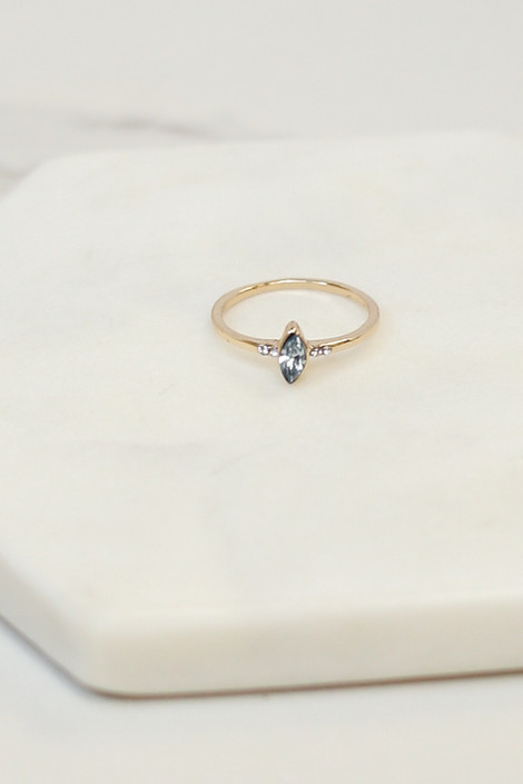 Flat Lay of  sapphire ring from the Gold Stone Dainty Ring Set