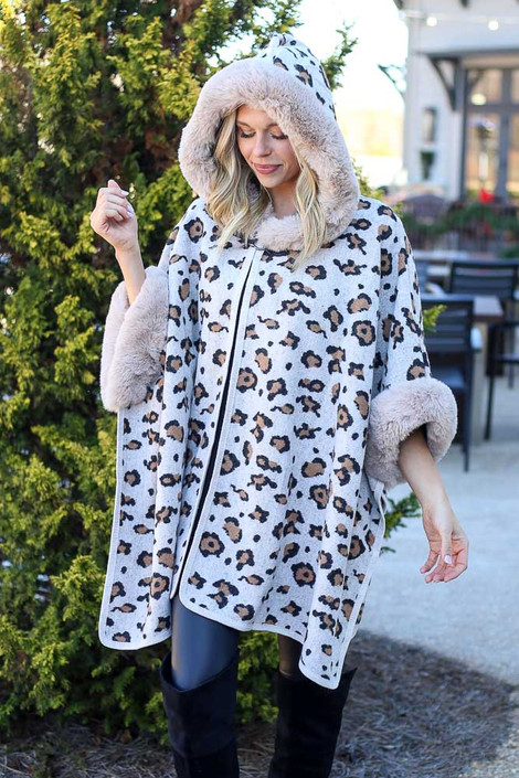 Model wearing the Fur Lined Leopard Knit Cape with skinny jeans and over the knee boots from Dress Up