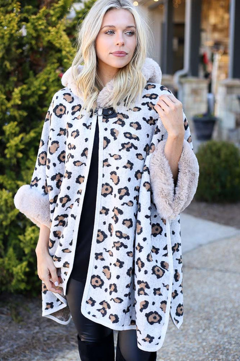Model wearing the Fur Lined Leopard Knit Cape with over the knee boots from Dress Up Front View