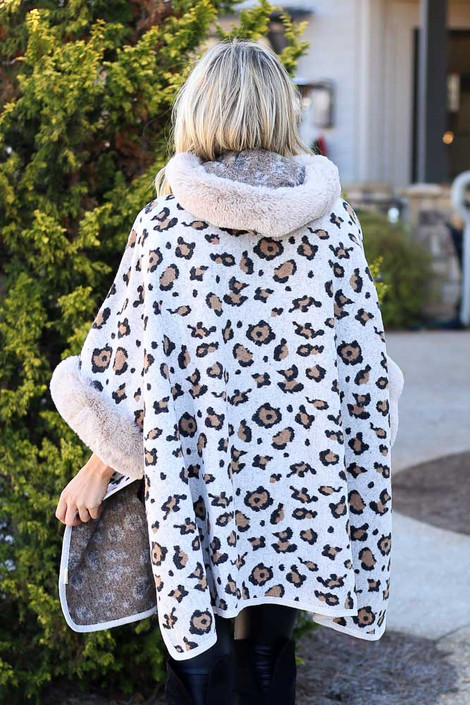 Model wearing the Fur Lined Leopard Knit Cape with over the knee boots from Dress Up Back View