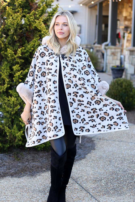Model wearing the Fur Lined Leopard Knit Cape with over the knee boots from Dress Up Full Outfit View