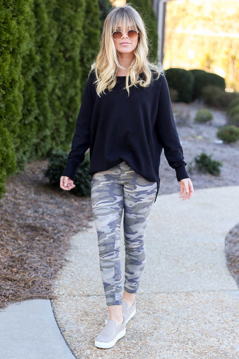 Model wearing the French Terry Camo Leggings with sneakers Front View