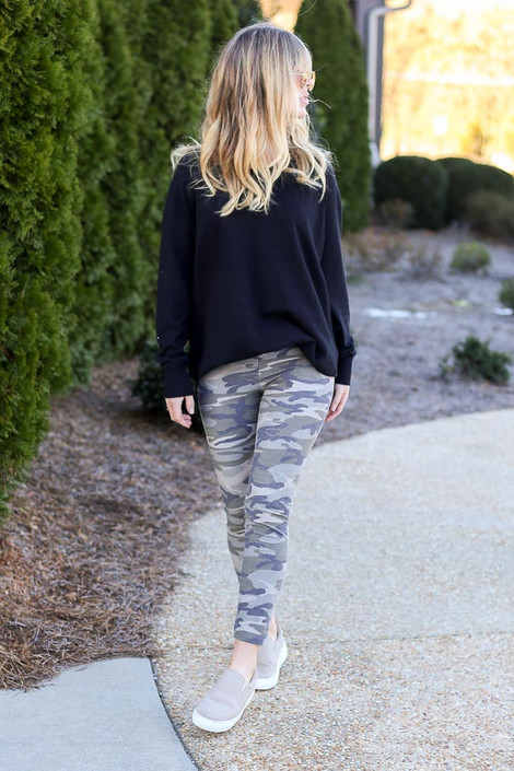 Model wearing the French Terry Camo Leggings with a black pullover Front View