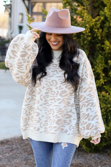 Model wearing the Leopard Brushed Knit Oversized Sweater with Wide Brim Hat and distressed jeans from Dress Up Front View
