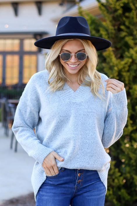 Model wearing the Brushed Knit Oversized Sweater in Heather Grey with wide brim hat from Dress Up Front View