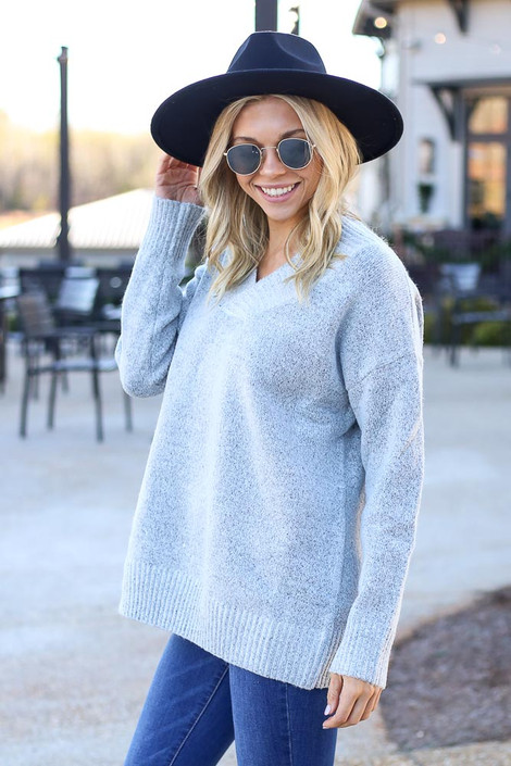 Model wearing the Brushed Knit Oversized Sweater in Heather Grey with wide brim hat from Dress Up Side View
