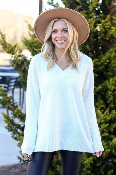 Model wearing the Brushed Knit Oversized Sweater in Ivory with wide brim hat from Dress Up Front View