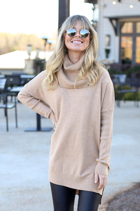 Model wearing the Soft Knit Turtleneck Tunic in Camel with faux leather leggings from Dress Up Front View