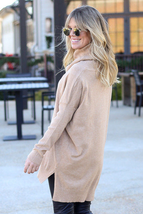Model wearing the Soft Knit Turtleneck Tunic in Camel from Dress Up Back View