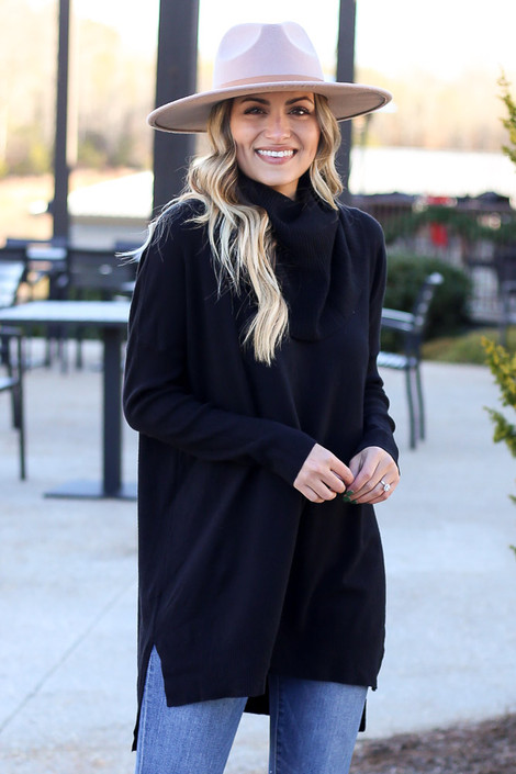 Model wearing the Soft Knit Turtleneck Tunic in Black from Dress Up