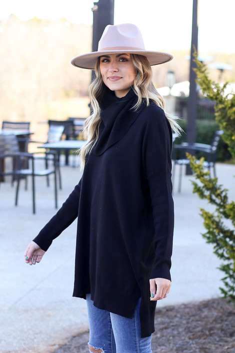 Model wearing the Soft Knit Turtleneck Tunic in Black from Dress Up Side View