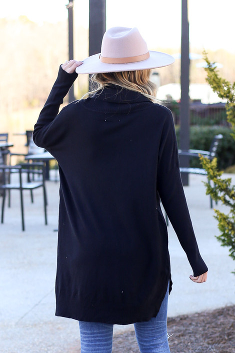 Model wearing the Soft Knit Turtleneck Tunic in Black from Dress Up Back View
