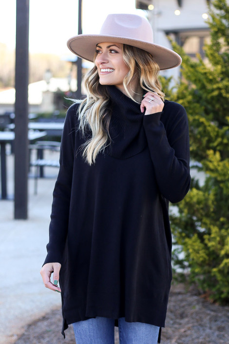 Model wearing the Soft Knit Turtleneck Tunic in Black from Dress Up Front View