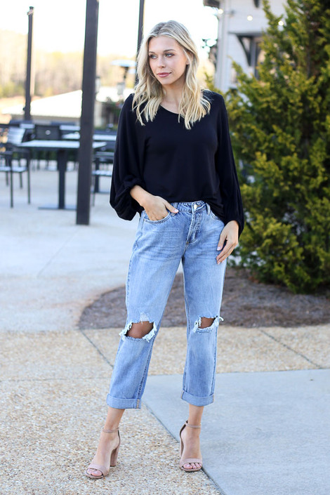 Model wearing the High Rise Distressed Boyfriend Jeans with heels from Dress Up Boutique Front View