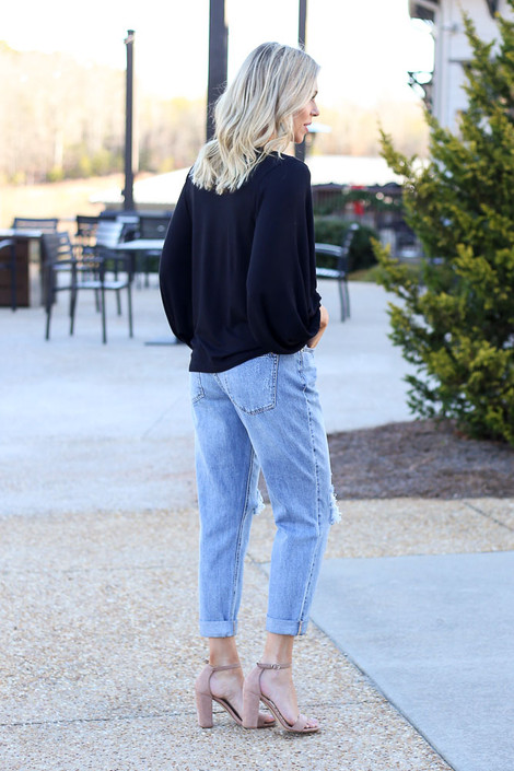 Model wearing the High Rise Distressed Boyfriend Jeans from Dress Up Boutique Side View