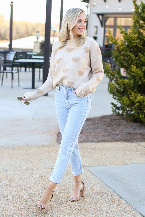 Model wearing the Light Wash High Rise Skinny Jeans with a knit sweater and heels from Dress Up Front View