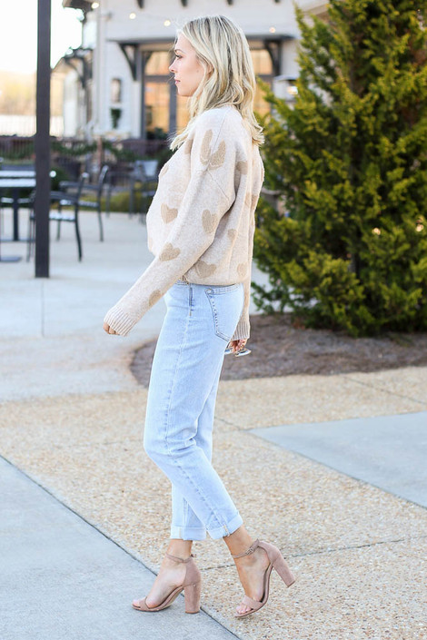 Model wearing the Light Wash High Rise Skinny Jeans with a knit sweater and heels from Dress Up Side View
