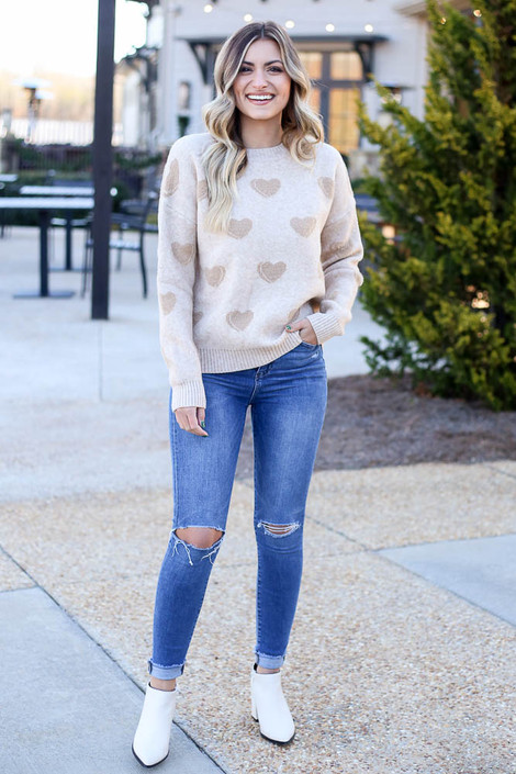 Model wearing the Taupe Eyelash Knit Heart Sweater with medium wash jeans from Dress Up Full Outfit View