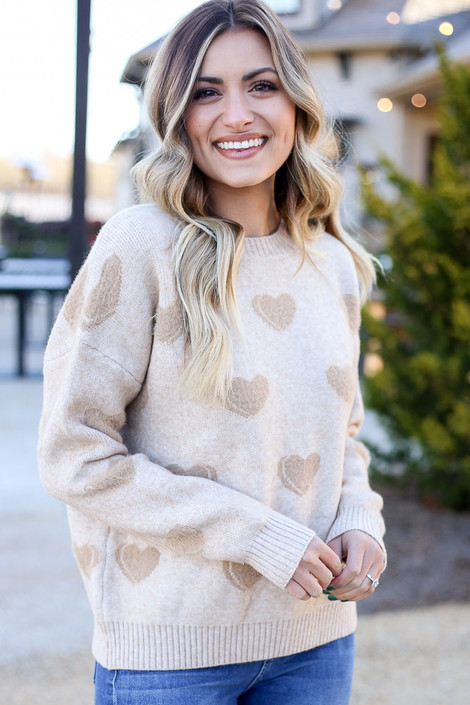 Model wearing the Taupe Eyelash Knit Heart Sweater with medium wash jeans from Dress Up Front View