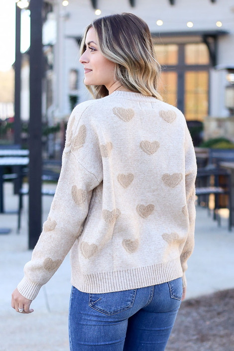 Model wearing the Taupe Eyelash Knit Heart Sweater with medium wash jeans from Dress Up Back View