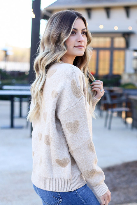 Model wearing the Taupe Eyelash Knit Heart Sweater with medium wash jeans from Dress Up Side View