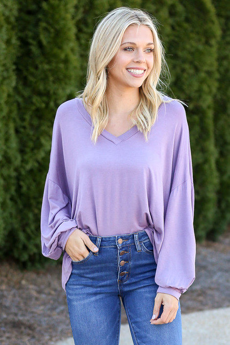 Jersey Knit Balloon Sleeve Top in Purple tucked into skinny jeans