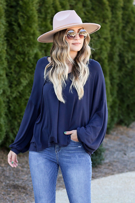 Jersey Knit Balloon Sleeve Top in navy with a wide brim hat