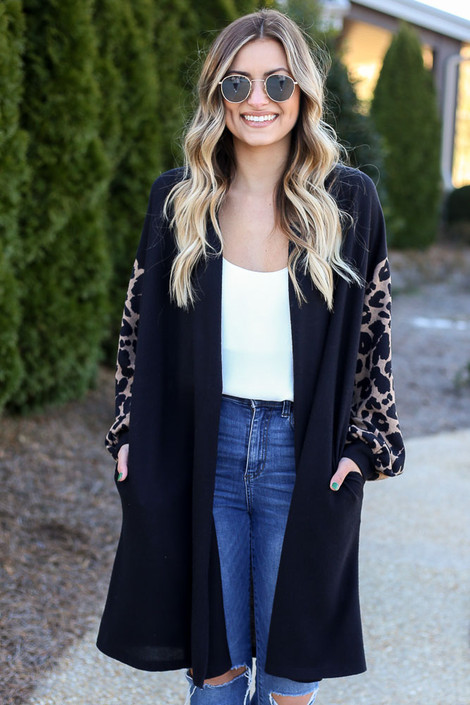 Model wearing the Leopard Sleeve Longline Cardigan with white cami and high rise jeans from Dress Up Front View