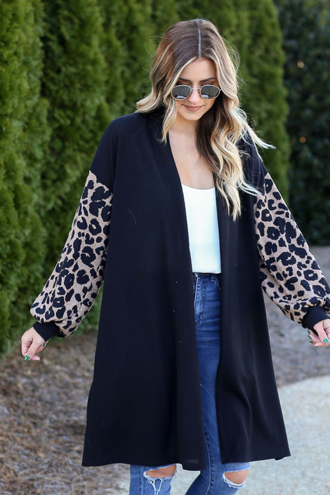 Model wearing the Leopard Sleeve Longline Cardigan with high rise jeans from Dress Up Front View
