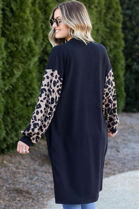 Model wearing the Leopard Sleeve Longline Cardigan with high rise jeans from Dress Up Back View
