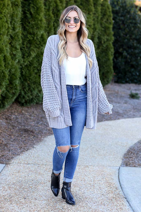Grey - Dress Up model wearing the Cable Knit Chenille Cardigan with distressed skinny jeans and a white tank top