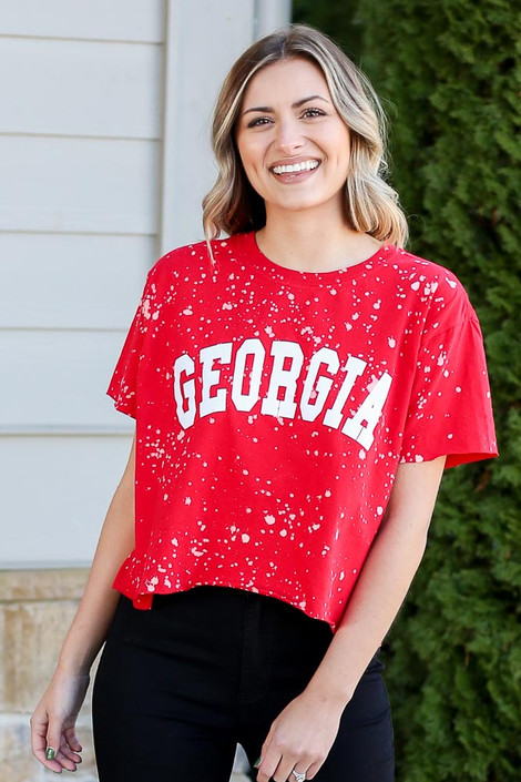 Model wearing the Red Georgia Acid Washed Graphic Tee from Dress Up in Large Close Up View
