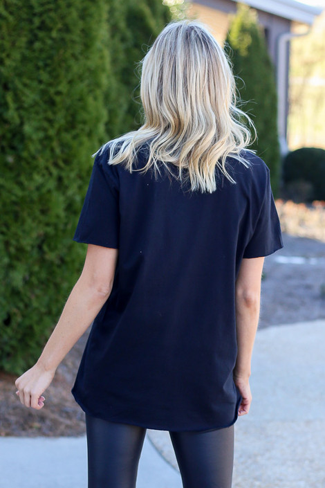 Model wearing the Black GA Star Girl Graphic Tee in Large with faux leather leggings Back View