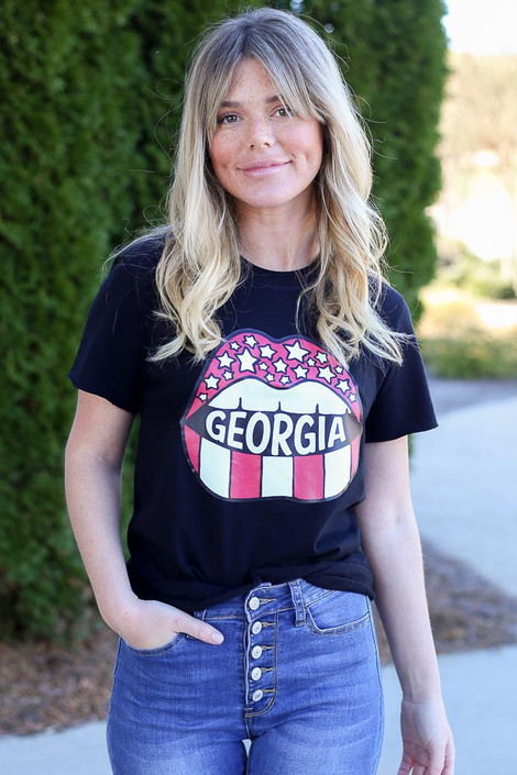 Model wearing the Black GA Star Girl Graphic Tee in Small with high rise skinny jeans Front View